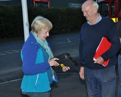 Eunice Doswell, deputy and David McFarland, chairman of Marden History Group examining the defibrillator – A. L.
