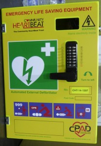 The box with the key code which holds the defibrillator. E. D.